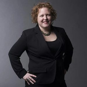 Jessica Piedra wearing black suit