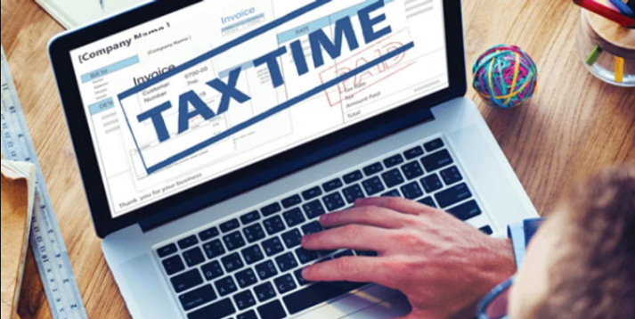 Laptop with Tax time text on screen